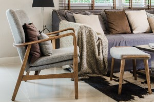 modern wood chair with pillow in living room at home